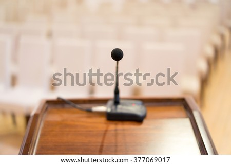 Close up shot of microphone on conference. - stock photo