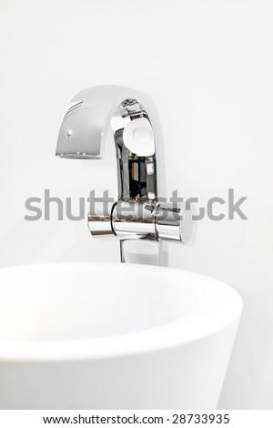 Close up shot of modern metallic faucet - stock photo
