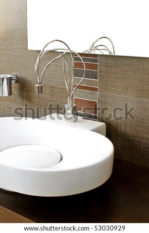 Close up shot of modern wire faucet - stock photo