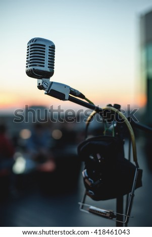 close up shot of musical microphone; professional audio equipment for concerts and conferences; - stock photo