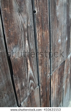 Close-up shot of Old vintage weathered planked wood wall. Shallow depth-of-field. Could be easily used in any design. - stock photo