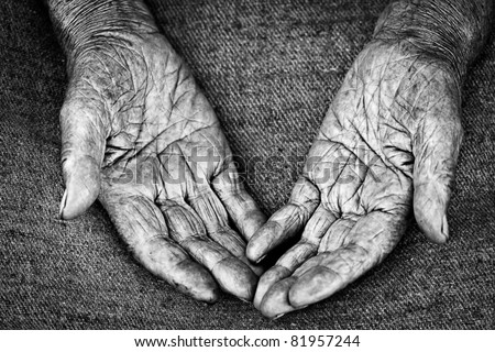 close-up shot of open palms of old woman, shallow DOF - stock photo