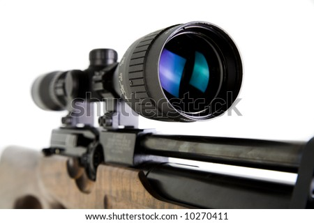 Close-up Shot of Precision Lens Scope on Snipers Rifle - stock photo