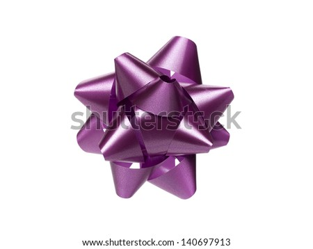 Close-up shot of purple Christmas gift bow isolated over white background. - stock photo