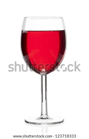 Close-up shot of red wine in wineglass isolated over plain white background. - stock photo