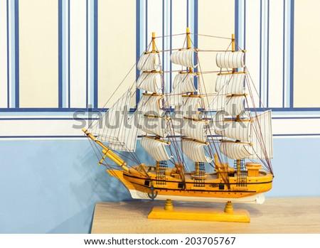 Close up shot of sail ship model - stock photo