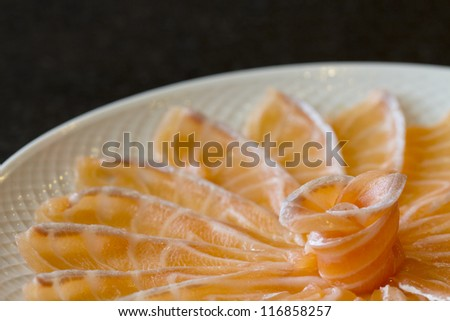 close up shot of salmon sashimi - stock photo