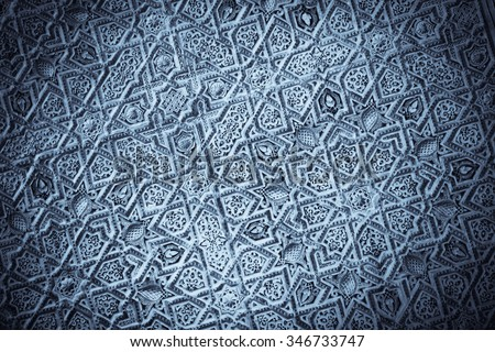 Close up shot of some Arabic decorations at the Alhambra palace in Granada, Spain. - stock photo