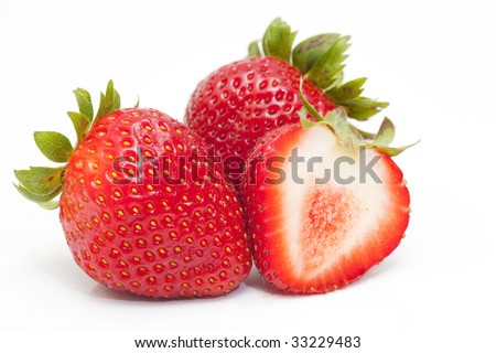 close up shot of tasty strawberries isolated against white background - stock photo