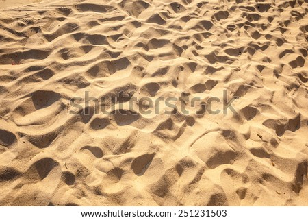 close up shot of the clean sand on a tropical island with footprints - stock photo