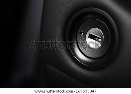 Close up shot of the ignition keyhole in a car - stock photo