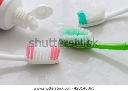 close up shot of toothbrush and toothpaste - stock photo