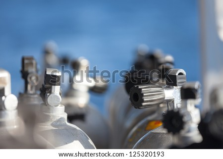 Close-up shot of valves with very short depth of field on scuba equipment. - stock photo