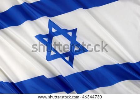 Close up shot of wavy blue and white Israeli flag - stock photo