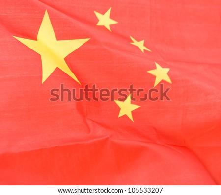 Close-up shot of wavy China flag. - stock photo