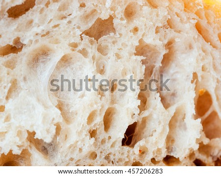 close up shot of white sourdough bread slice. Macro of bread slice texture. Tasty fresh bread, close up for background - stock photo
