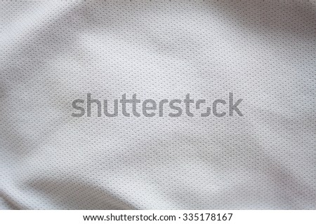 Close up shot of white textured football jersey - stock photo