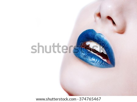 Close-up shot of woman lips with glossy blue lipstick - stock photo