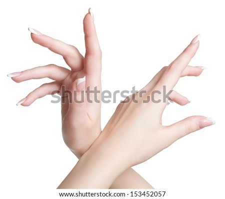 close-up shot of young woman's hands with manicure on white - stock photo