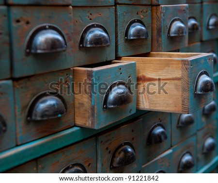 Close up shot on an apothecary chest with open drawers - stock photo