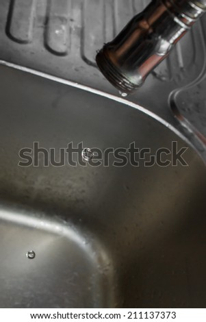 close up shot on water hose with water drop. - stock photo