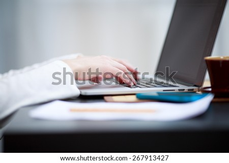 Close-up shot typing on the laptop keyboard - stock photo