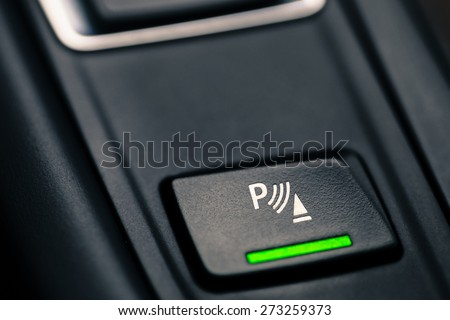 Close-up shot with the detail of a parking brake in a car. - stock photo