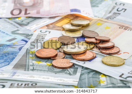 close-up shots in macro lens money euro coins and banknotes - stock photo