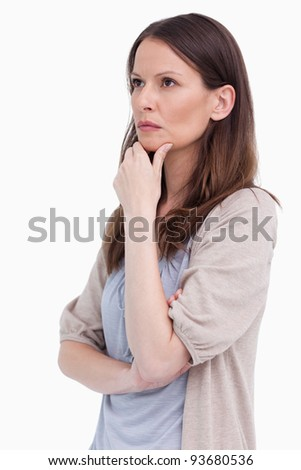 Close up side view of thoughtful woman against a white background - stock photo