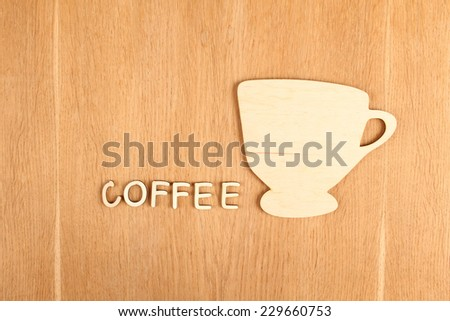 Close-up silhouette of a wooden cup. Background - stock photo