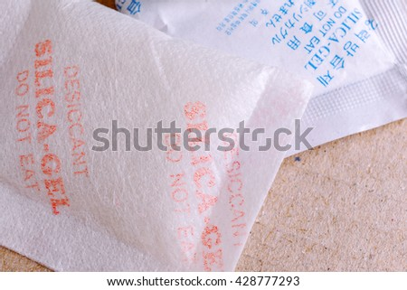 Close up silica gel or desiccant in paper bag background - stock photo