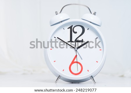 Close up Simple White Alarm Clock Isolated on White Background - stock photo