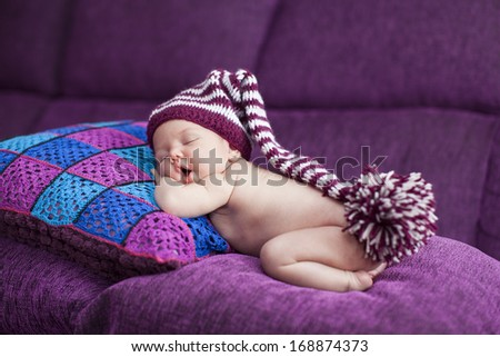 Close-up sleeping newborn  with  hat - stock photo