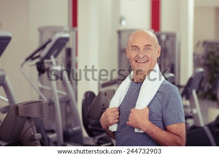 Close up Smiling Old Man, with Towel at his Shoulder, at the Fitness Gym. Looking at the Camera - stock photo