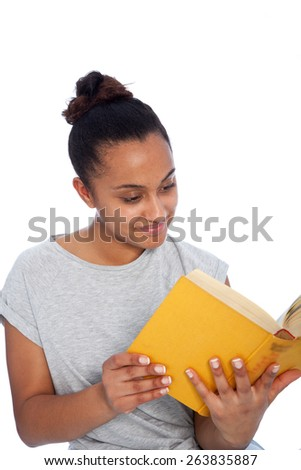 Close up Smiling Young Asian Indian Woman in Casual Shirt Reading a Yellow Book, Isolated on White Background. - stock photo