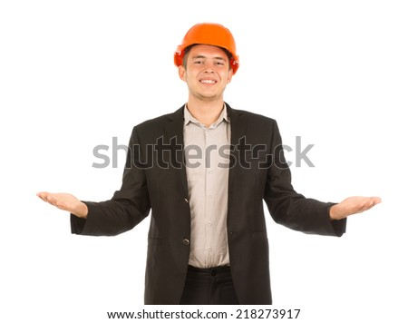 Close up Smiling Young Male Engineer in Black Coat and Orange Helmet. Opening his Palms Facing Upward. Isolated on White Background. - stock photo