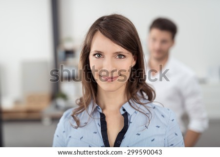 Close up Smiling Young Professional Woman Working In an Office, Looking at the Camera. - stock photo
