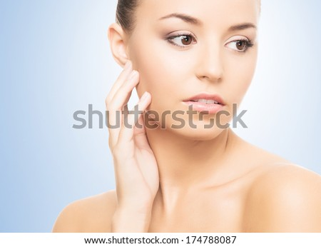 Close-up spa portrait of young, beautiful and healthy girl over blue background - stock photo