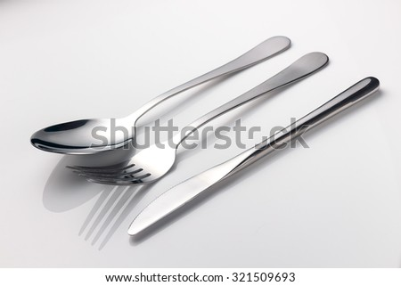 close up spoon, fork, knife - stock photo