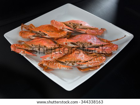 Close-up steamed crabs on black background - stock photo