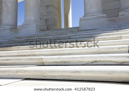 Close up steps and column. Pillars. Steps to the sky. Blue sky background - stock photo