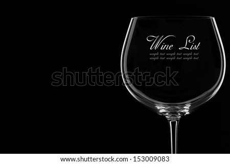 Close-up Studio Shot of  a Wine Glass on a Black Background.Copy Space. - stock photo