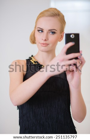 Close up Stylish Pretty Young Woman in Black Sleeveless Dress Calling on Phone. - stock photo