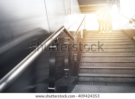 Close-up subway station stair armrest   Subway stairs   - stock photo