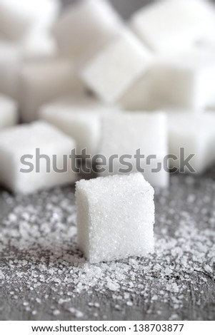 close up sugar cube on gray background - stock photo