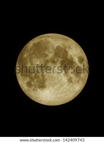 Close up surface textured of yellow full moon, lunar on dark night sky, black space background - stock photo
