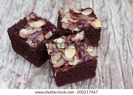 Close up sweet almond brownie on old wood background - stock photo