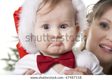 close-up sweet baby in Santa's hat - stock photo