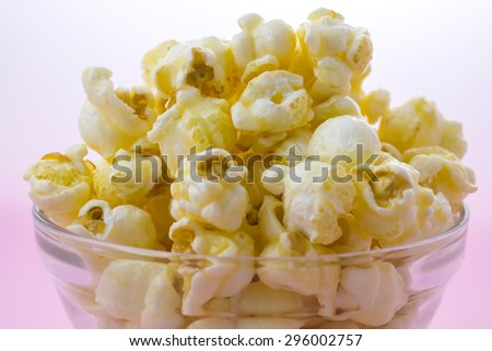 Close up Sweet Popcorn in the bowl on pink background  - stock photo