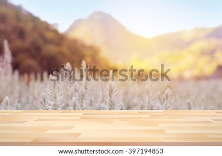 Close up terrace with blurred landscape and sunny day - stock photo